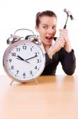 Woman desperate with time hitting clock with hammer — Stock Photo
