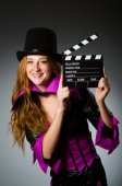 Woman with movie clapboard against grey background — Stock Photo