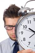 Man with clock trying to meet the deadline isolated on white — Stok fotoğraf