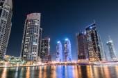 Dubai marina skyscrapers during night hours — Stock Photo