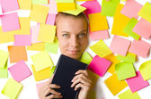 Woman with many reminder notes reading book — Stock Photo