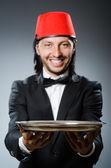 Waiter wearing traditional turkish hat  — Stock Photo