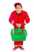 Man in red coveralls with shopping supermarket cart trolley — Stock Photo