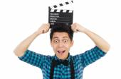 Man with movie clapperboard isolated on white — Stock Photo