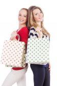 Amigos com sacos de compras, isolados no branco — Fotografia Stock