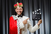 King with movie board in funny concept — Stock Photo