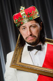 King with picture frame in funny concept — Foto de Stock