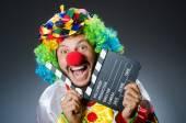 Clown with movie clapper board — Stockfoto