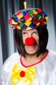 Sad clown against grey background — Stock Photo