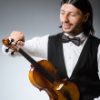 Funny fiddle violin player in musical concept — Stock Photo #53438819