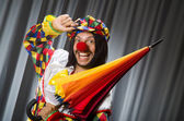 Funny clown with colourful umbrella  — Stock Photo