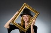 Woman with vintage hat and picture frame — Stock Photo