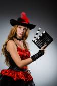 Woman in pirate costume with movie board — Stock Photo