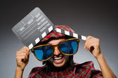 Funny scotsman with movie clapboard — Stock Photo