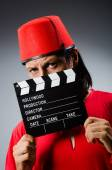 Man wearing fez hat with movie board — Stock Photo