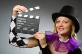 Woman magician doing her tricks with wand — Stock Photo
