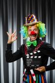 Clown with movie clapper board — Stock Photo