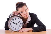 Businesswoman with clock missing her deadlines — Stock Photo