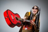 Guitar player with red instrument — Stock Photo