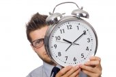Man with clock trying to meet the deadline isolated on white — Stockfoto
