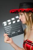 Funny mexican woman with sombrero and movie clapboard — Stock Photo