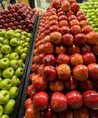 Apple stall in big supermarket — Stock Photo