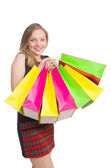 Woman after shopping spree on white — Stock Photo