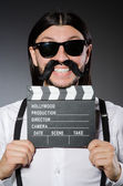 Funny man with movie clapboard — Foto de Stock