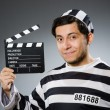 Inmate with movie clapper board — Stock Photo #53835691