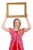 Woman holding picture frame isolated on white — ストック写真