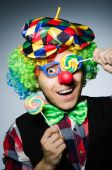 Funny clown with sweet lollipop — Stock Photo