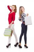Friends with shopping bags isolated on white — Stock Photo
