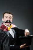 Funny magician with wand and hat — Stock Photo