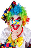 Clown with lollipop isolated on white — ストック写真