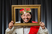 King with picture frame in funny concept — Stockfoto