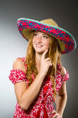 Mexican woman wearing red sombrero — Stock Photo