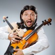 Funny fiddle violin player in musical concept — Stock Photo #53858569