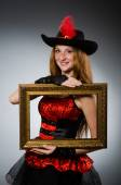 Woman pirate with picture frame — Stockfoto
