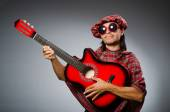 Funny scotsman playing red guitar — Stock Photo