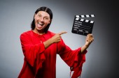 Man in red dress with movie clapboard — ストック写真