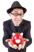 Funny man with piggybank on white — Stock Photo