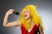 Young woman with mic in music concept — Stock Photo