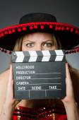 Funny mexican woman with sombrero and movie clapboard — Stockfoto