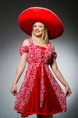 Woman wearing nice red sombrero — Stock Photo