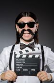 Funny man with movie clapboard — Stockfoto
