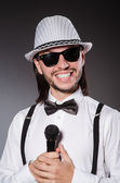 Funny singer with microphone at the concert — Stock Photo