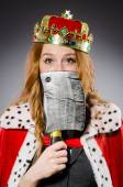 Woman queen businesswoman with axe — Stock Photo