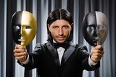 Funny concept with theatrical mask — Stock Photo