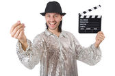 Man with movie clapperboard and hat — Stock Photo