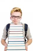 Studente divertente con una pila di libri — Foto Stock